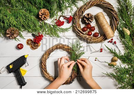 Christmas wreath decoration with handmade DIY, do it by yourself. Top view. Copy space. Flat lay. Still life.