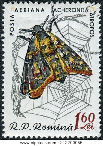 ROMANIA - CIRCA 1960: Postage stamp printed in Romania shows Death's-head Hawk Moth (Acherontia atropos) circa 1960