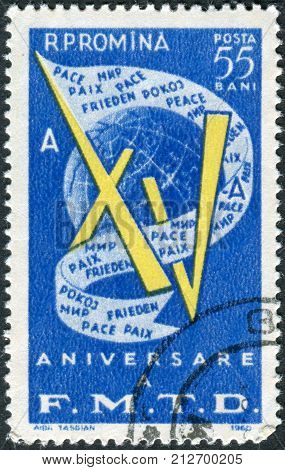 ROMANIA - CIRCA 1960: Postage stamp printed in Romania dedicated to the Fifteenth Anniversary of World Federation of Democratic Youth shows Globe and flag with inscription circa 1960