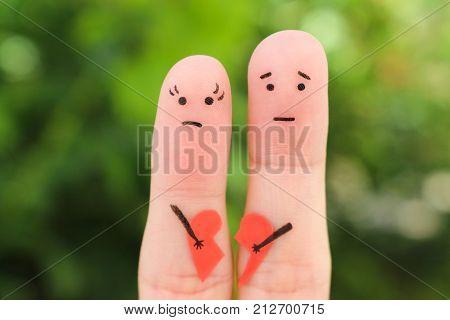 Fingers art of sad couple. Woman and man holding broken heart.