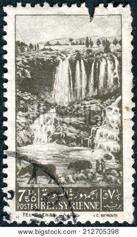 SYRIA - CIRCA 1949: Postage stamp Syria shows Tel-Chehab waterfall circa 1949
