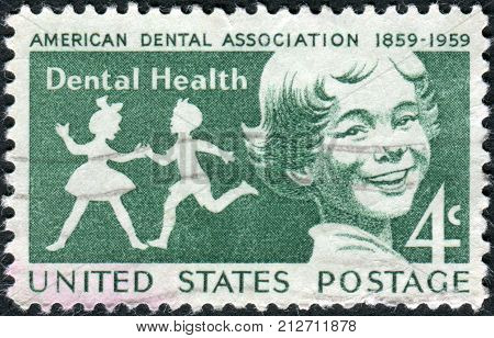 USA - CIRCA 1959: Postage stamps printed in USA Dental Health Issue Publicizing dental health and centenary of the American Dental Association shows children circa 1959