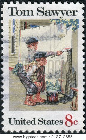 USA - CIRCA 1972: A postage stamp printed in USA American Folklore Issue shows Tom Sawyer by Norman Rockwell circa 1972. Tom Sawyer hero of