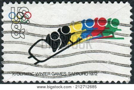 USA - CIRCA 1972: A postage stamp printed in the USA dedicated to the 11th Winter Olympic Games Sapporo Japan shows Bobsledding circa 1972