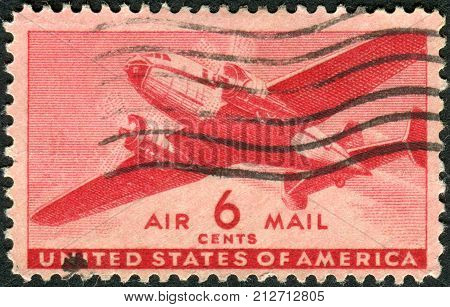 USA - CIRCA 1941: Postage stamps printed in USA shows Twin-Motored Transport Plane circa 1941