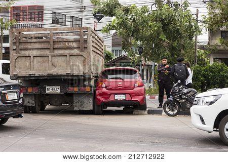 Truck accidentally crash in to a car at a U-Turn on Ramkamhaeng Street Bangkok Thailand ;14.50 pm 8 Nov 2017