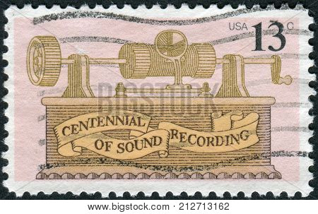 USA - CIRCA 1977: A postage stamp printed in the USA dedicated to the centenary of invention of the phonograph by Thomas Alva Edison and development of sophisticated recording industry shows a Tin Foil Phonograph circa 1977