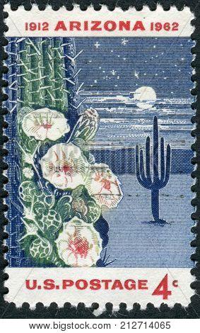 USA - CIRCA 1962: Postage stamp printed in the USA dedicated to the 50th anniversary of Arizona Statehood shows Giant Saguaro Cactus circa 1962