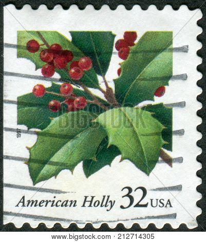 USA - CIRCA 1997: Postage stamps printed in USA Christmas Issue shows American Holly (Ilex opaca) circa 1997
