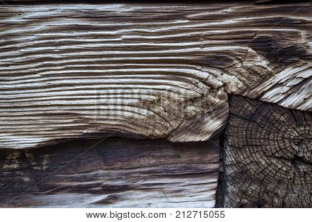 Juncture Of Old, Weathered Wood Timbers Showing Side And End Grains And Burn Marks