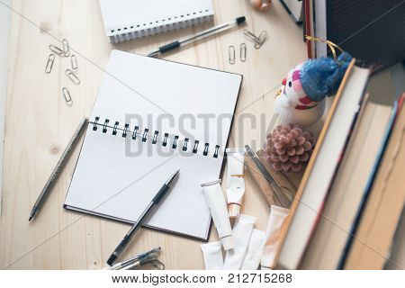 Clutter On The Student's Desk, Notebook, Pens, Paints, Books