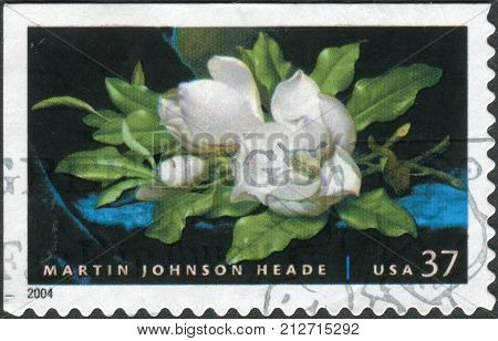 USA - CIRCA 2004: Postage stamp printed in the USA shows a Giant Magnolias on a Blue Velvet Cloth by Martin Johnson Heade circa 2004