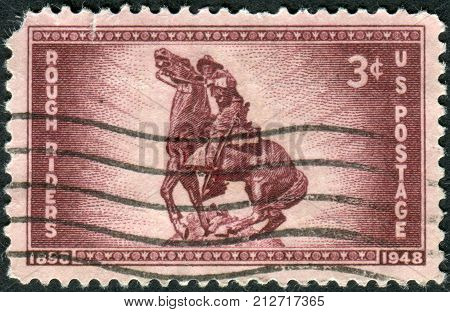 USA - CIRCA 1948: Postage stamp printed in the USA dedicated to the 50th anniversary of the organization of the Rough Riders of the Spanish-American War shows Statue of Capt. William Owen
