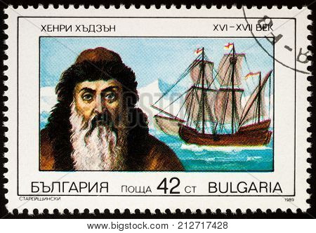 Moscow Russia - November 07 2017: A stamp printed in Bulgaria shows Captain Henry Hudson (1570-1611) and his ship Halve Maen (Half Moon) series