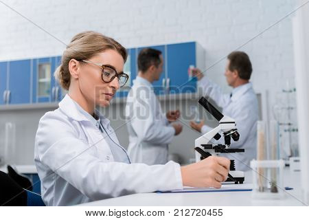 Lab Technician Taking Notes