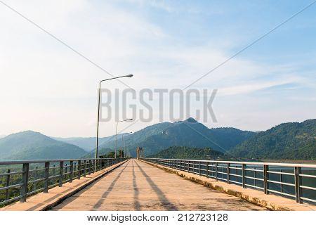 Stone Bridge Walkway River And Mountain Landscape View At Khun Dan Prakarn Chon Dam. Landmarks In Na
