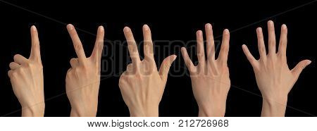 one, two, three, four, five fingers on a hand on a black background .