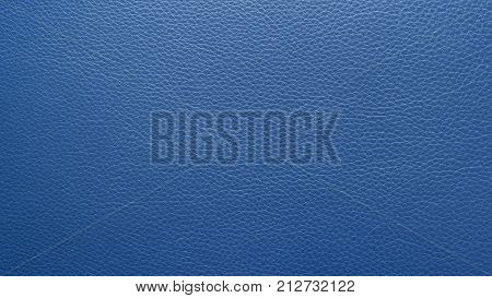 Embossed (texture) midnight blue genuine leather background