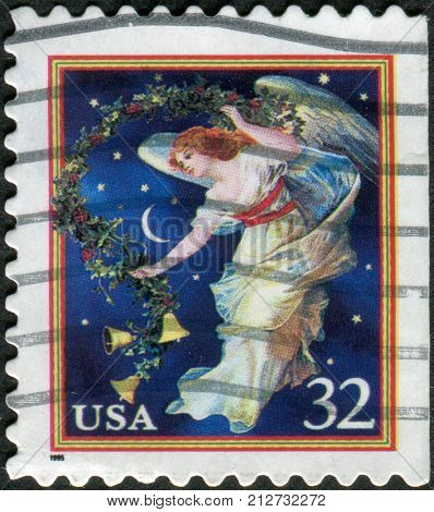 USA - CIRCA 1995: Postage stamps printed in USA Christmas Issue shows a Midnight Angel circa 1995