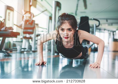 Asian Woman Fitness Girl Do Pushing Ups At Fitness Gym. Healthcare And Healthy Concept. Training And