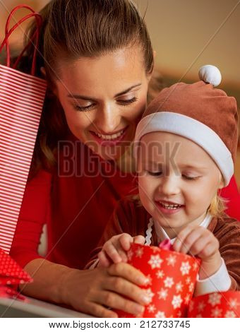 Happy Mother And Baby Checking Christmas Purchases