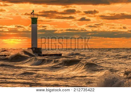 Lighthouse And Pier On Lake Huron Under A Stormy Sky - Ontario, Canada