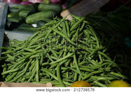 Green String Beans Lie On The Counter In The Market