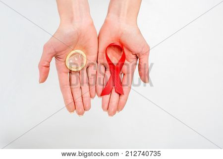 Woman Holding Aids Ribbon And Condom