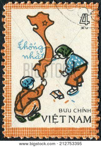 VIETNAM - CIRCA 1977: Postage stamp printed in Vietnam shows Children drawing map of unified Vietnam circa 1977