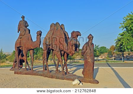 Samarkand: monument to caravan of camels in desert