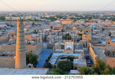 Khiva: view of the medieval skyline on sunset