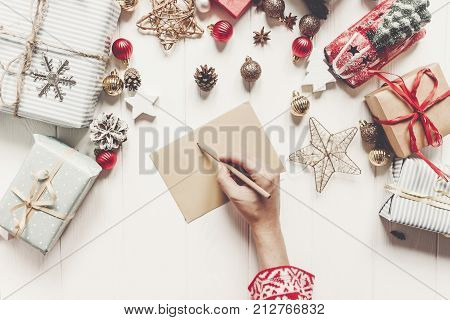 Hands Holding Pencil And Writing A Letter Wish List To Santa Claus Flat Lay With Space For Text. Mer