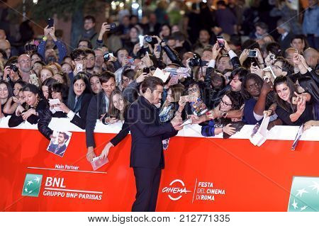 ROME ITALY - OCTOBER 28: Jake Gyllenhaal signs autographs as he walks a red carpet for 'Stronger' during the 12th Rome Film Fest at Auditorium Parco Della Musica on October 28 2017 in Rome Italy.