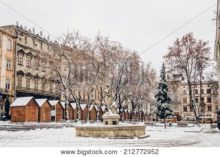 Beautiful City Center Covered In Snow. Snowy Town Square In Lviv. European City Before Christmas Hol