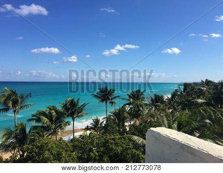 Beautiful ocean view from the balcony. Palm trees, ocean, Atlantic coast of Cuba, Varadero