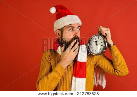 Winter Holiday And Countdown Concept. Santa Claus Waits For Midnight