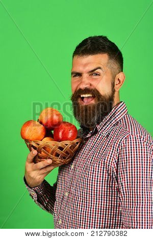 Farmer With Cheerful Face Holds Red Apples