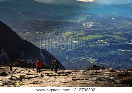 Ranau,Sabah,Borneo-March 13,2016:Climber carefully moving down from Low's Peak after successfully completed conquering the mountain Kinabalu at Sabah,Malaysia.