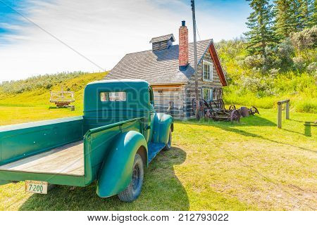 Longview August 2015 This old pick up is parked in front of an old house located in bar u ranch national historic site to show how do people lived in 19 th century