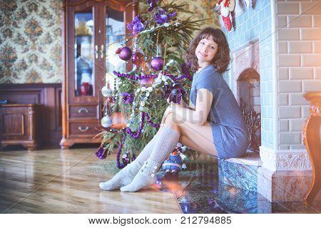 Beauty Glamor Woman Celebrating Christmas, Wearing A Carnival Cap.