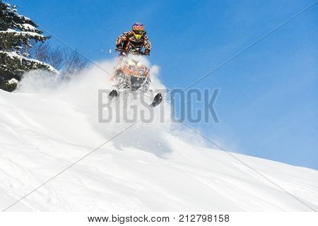 Rider on the snowmobile in the mountains ski resort in Sakhalin island Russia.
