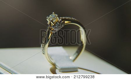Precious diamond rings. Fine luxury diamond jewellery window display with ring pedant. Gold ring with brilliant isolated on black background   poster
