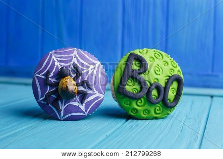 Halloween Party Sweets. Delicious Halloween Cupcakes With Spider And Word Boo Decorations Made Of Co