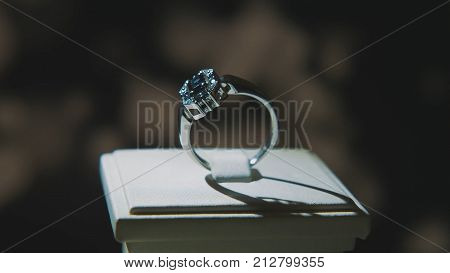 Precious diamond rings. Fine luxury diamond jewelry window display with ring pedant. Gold ring with brilliant isolated on black background  poster