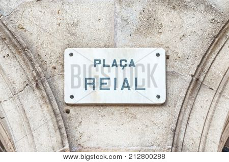 Street sign for Placa Reial sightseeing and iconic square of the Gothic Quarter in Barcelona Catalonia Spain