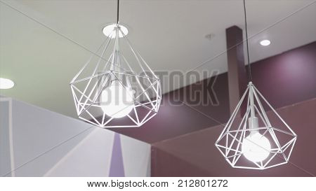 Fashion and hitech lamp in modern style. Warm tone light bulb lamp. Lamps in coffee shop and boutique.