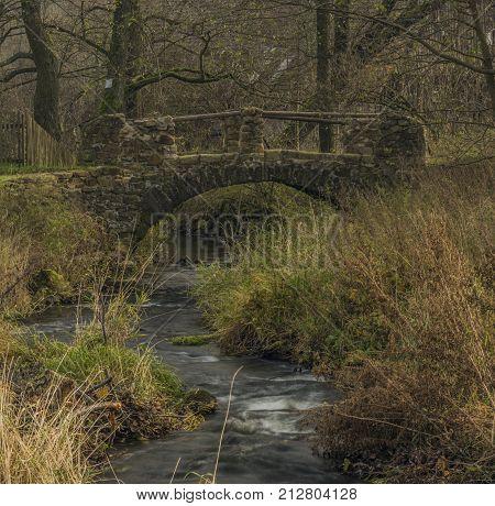 Stone bridge on Bobri creek in Ceske Stredohori mountains near Vernerice town part Loucky village