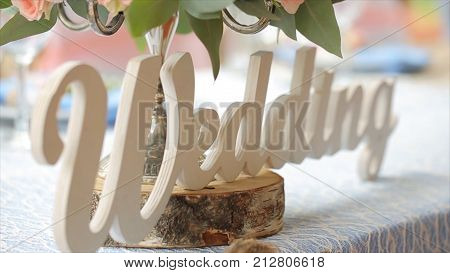 White wedding signage Wedding and Family stay at the table. Word wedding as signage lighting in ceremonial decoration HD