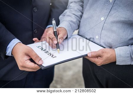 Car Insurance Agent Send A Pen To His Customers Sign The Insurance Form On Clipboard While Examining