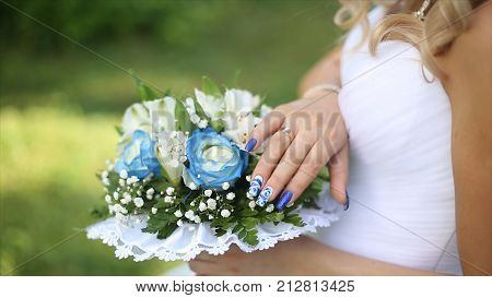 Beautiful bouquet of different colors in the hands of the bride in a white dress. Bride in white dress with bouquet Black woman holds wedding bouquet. Wedding HD